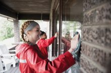 Illinois State students wash windows at a Normal home last April as part of Bring It Back to Normal.