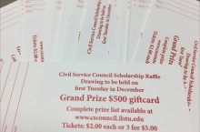 stack of raffle tickets with the words Civil Service Council Scholarship Raffle, drawing to be held on first Tuesday in December, Grand Prize $500 gift card, Complete prize list available at www.cscouncil.ilstu.edu, tickets $2 each or 3 for $5.
