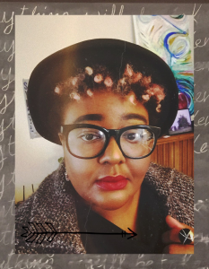 Author image wearing glasses and a hat