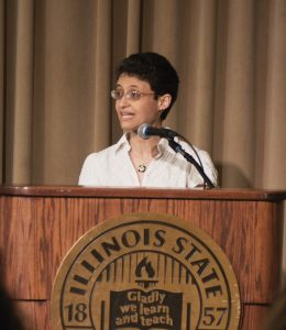 Noha Shawki, American Democracy Project faculty co-leader at a lecturn