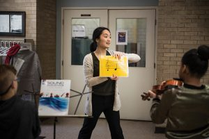Atsuko Masuyama teaches her young pupils how to play string music at the Western Avenue Community Center.