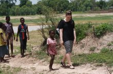 Abby Mustread, ISU Bone Scholar, walks with group of children in Africa.