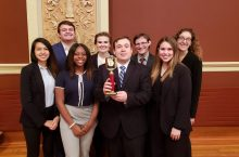 ISU Mock Trial Team with a trophy.