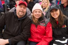 A family poses at the football game during Family Weekend