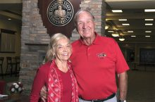 Margaret (Menne) and John Swalec standing in Alumni Center
