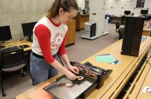 Student using Ellison Die Cutter at new Make it Space at Milner Library.