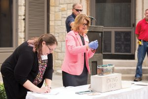 Ewing Director Toni Tucker (right) and Julie Neville of Illinois State's Dr. Jo Ann Rayfield Archives partnered in revealing the items from the time capsule.