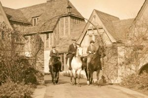 Members of the Ewing family out for a ride on horses at Ewing Manor