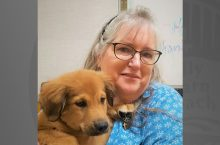 Valeri Farmer-Dougan headshot with puppy