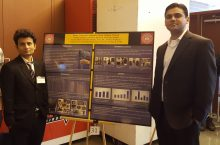 Samikaran Bhattarai with Associate Professor Pranshoo Solanki in front of poster display
