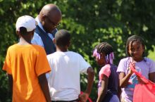 Charles Bell with several elementary school students