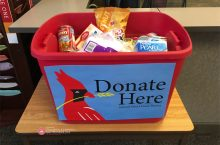 Red donation tub full of items with
