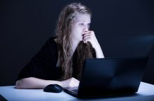 Picture of scared girl suffering from cyber bullying or cyber bullying