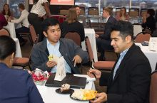 students meet with employers over dinner