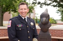 police officer next to Redbird bust