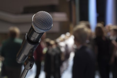 microphone and a crowd in the background