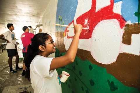 Bloomington-Normal youth paint a mural last summer as part of an Illinois Art Station led project along the Constitution Trail.