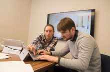 Torrey Saxton and Allison Harris doing the type of physics research that helped him land an internship at CERN.