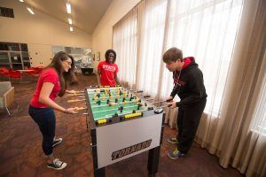 Students play foosball in residence hall