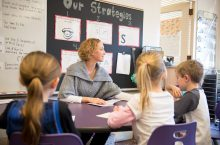 IL Teacher working with students to help her achieve National Board certification.