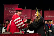 Kerri Milita receiving award from President Dietz