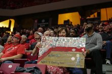 Redbird fan Lisa Moran at a game with one of her signs.