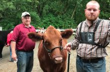 Bill Graff, his son, and a steer.