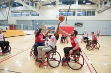 ISU students play wheelchair basketball during the fifth annual Adaptapalooza.