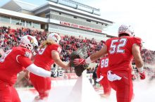 Redbird football players entering the field