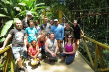 A group of people in front of a banana plantation