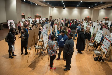 Lines of posters and students filled the Brown Ballroom for the annual Research Symposium.