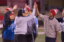 Students high fiving at Redbird Rumble