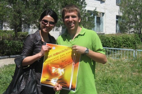 Hotard and woman with a poster