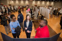 people discuss research poster