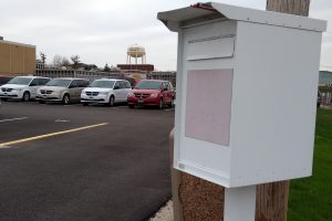 White metal drop box for fleet vehicle keys beside the F93 parking lot