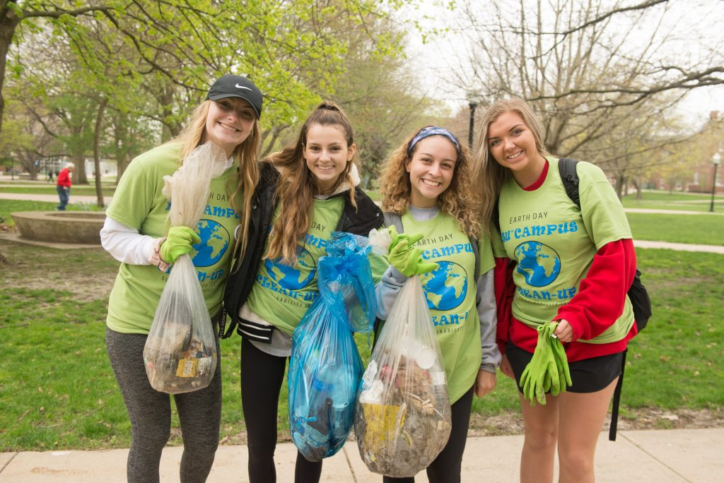 Students show off the waste they've collected for Campus Cleanup Day.