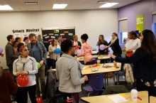 During Carrie Conover's teacher mood workshop, educators anxiously popped balloons to explain their specific moods and attitudes during the school day.