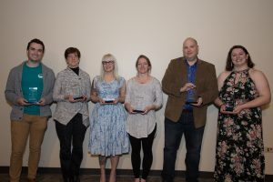 Civic engagement awards were picked up by Brendan Wall (left), on behalf o SERC; Kerri Calvert; Shelly Clevenger; Julie McCoy, on behalf of District 87; R.C. McBride, on behalf of WGLT; and Madison Kartcheske.