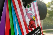 ISU Parking permits hang from the rearview mirror of a vehicle