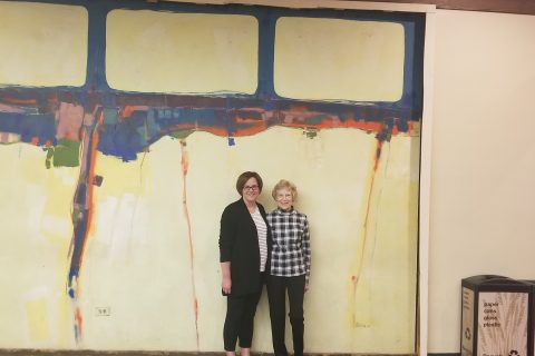 Assistant Professor Jennifer Peterson and her mother, Joan Steinburg, stand before the mural May 23. (Photograph courtesy of Bill Legett)