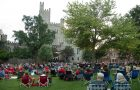 people sitting on lawn chairs and blankets on the Illinois State University Quad