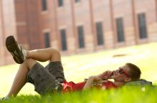 student relaxing on Quad
