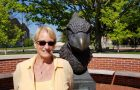 Judy Duncan standing by the Reggie statue