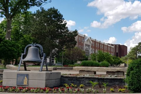 Schroeder Hall and the bell in the Quad