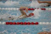 Molly Hill swims during recent competition.