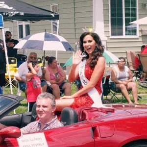 Miss Illinois Ariel Beverly being driven through the Fourth of July parade in her hometown of East Moline.