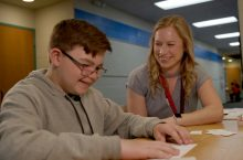 Teacher of the Year Kateri Gullifor assists a visually impaired student