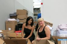 Viridiana Lopez and Nadia Chiavola help unbox items for the trunk drive