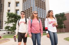 Three students Walking from Watterson Towers