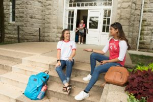 Students talking on the steps of Cook Hall